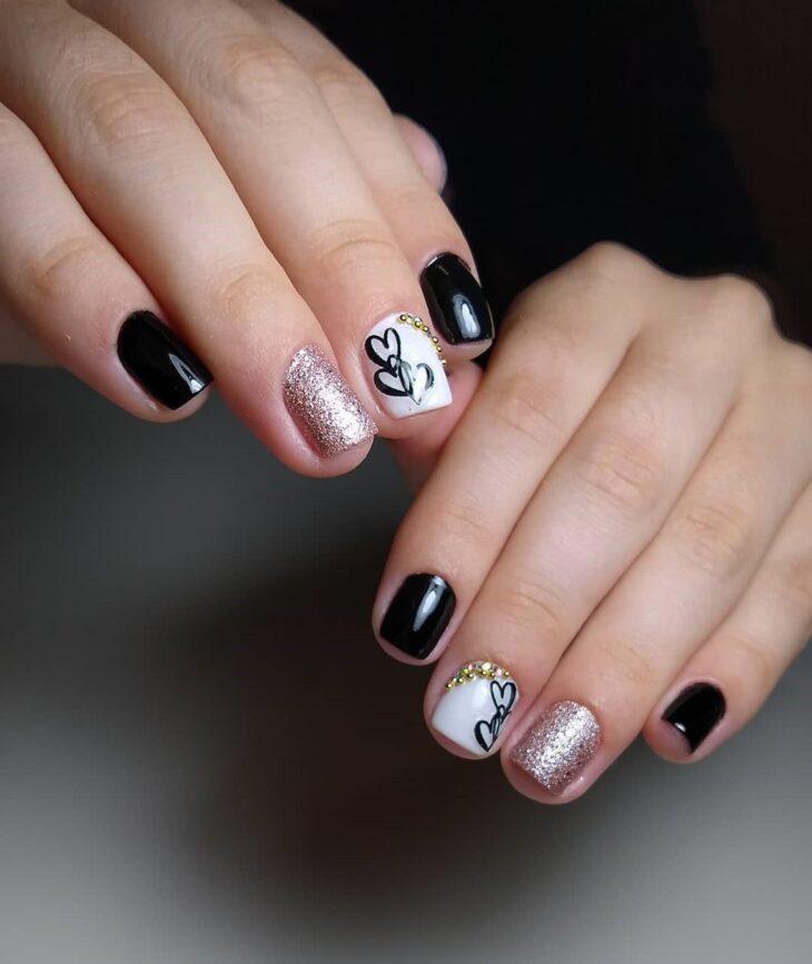 unhas decoradas em preto e branco 35